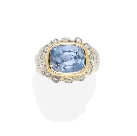 A sapphire, diamond and bi-color gold ring