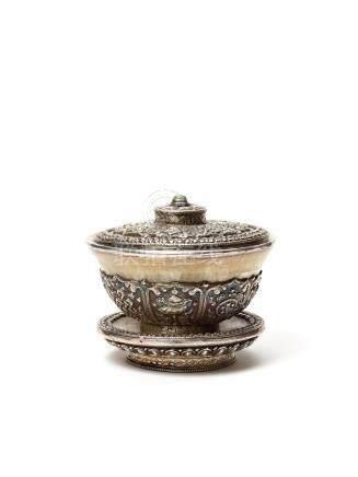 A FINE TIBETAN BUDDHIST SILVER TEA BOWL, 19TH CENTURY