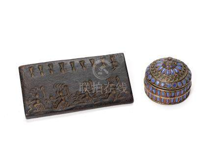 A SILVER BOX AND COVER AND A WOODEN PANEL WITH FIGURAL …