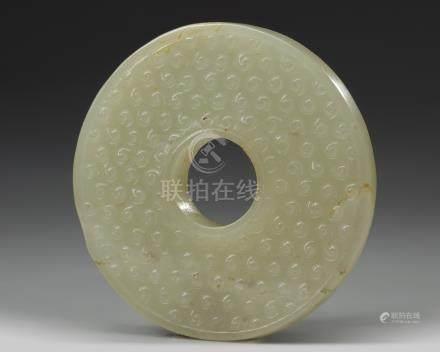 A jade carving of a bi disc