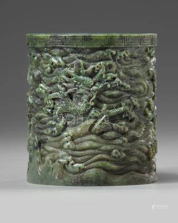 A carved spinach green jade brush pot
