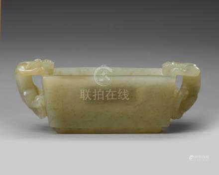 A small jade rectangular bowl
