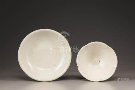 A white-glazed bowl and plate