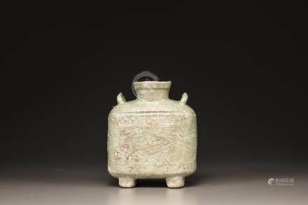 A green-glazed pottery flask