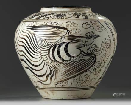 A large Chinese Cizhou-style 'dragon and phoenix' jar