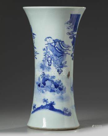 A Chinese blue and white 'Immortals' beaker vase