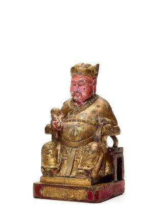 A POLYCHROME LACQUERED AND GILT WOOD FIGURE OF GUANDI, …