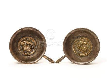 A PAIR OF COPPER REPOUSSÉ AND SILVERED METAL VESSELS, T…