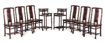A set of six simulated bamboo hardwood dining chairs and a p