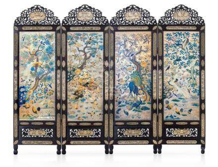 An impressive embroidered silk and ivory-inset carved wood f