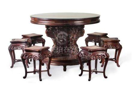 A hardwood centre table and a set of six marble inlaid stool