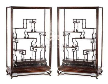 A pair of glazed display cabinets (4) each cabinet 84.5 cm h