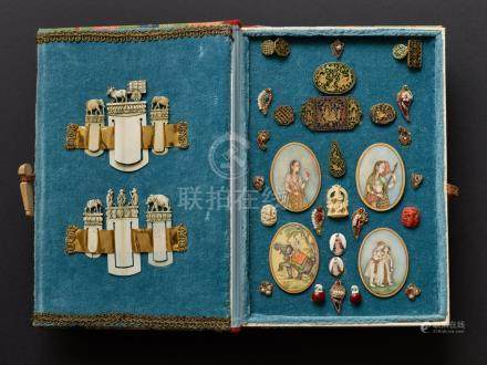 A COLLECTION OF MINIATURE COLLECTIBLES IN CASE