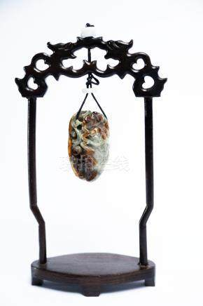 A Chinese Jade Cicada with wooden stand