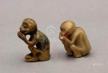A pair of 20th century Chinese carved hardstone monkey shape