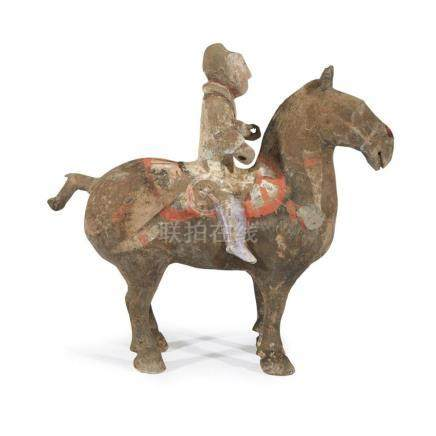 A Chinese painted grey pottery horse and rider, Shaanxi prov
