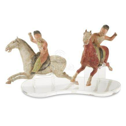 A pair of painted pottery Polo Players, Tang dynasty