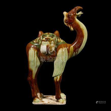 A Chinese sancai-glazed pottery model of a camel, Tang dynas