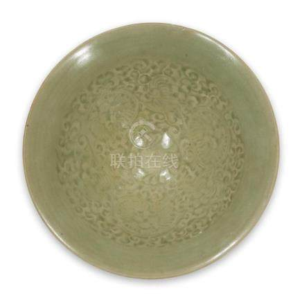 A Chinese Yaozhou-type molded conical bowl, Northern Song/Ji