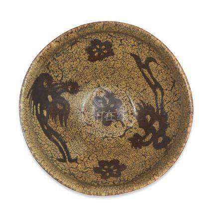 "A Chinese Jizhou ""Phoenix and Floret""""paper-resist"" teabowl,"
