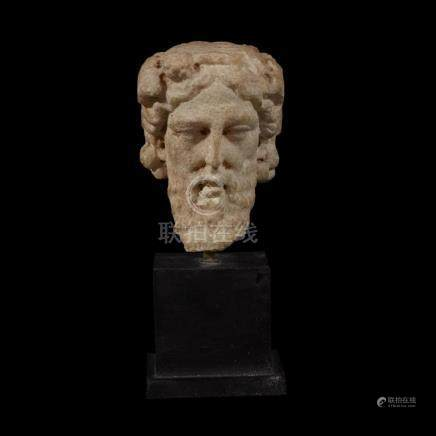 ROMAN JANIFORM HEAD OF DIONYSOS, 1st Century AD