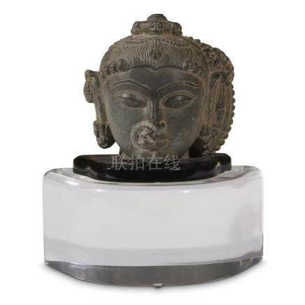 JAIN HEAD OF A TIRTHANKARA, North India, 11th-12th Century