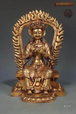 A GITL-BRONZE FIGURE OF SEATED BUDDHA, YONGLE MARK