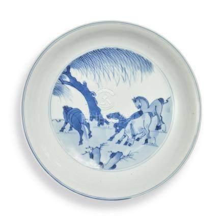 A BLUE AND WHITE 'EIGHT HORSES OF MU WANG' DISH Kangxi Mark and Period