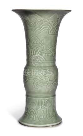 A CARVED CELADON-GLAZED BEAKER VASEQing Dynasty, Kangxi Period