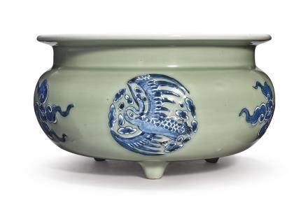A CELADON-GROUND BLUE AND WHITE SLIP-DECORATED TRIPOD CENSERQing Dynasty, Kangxi Period