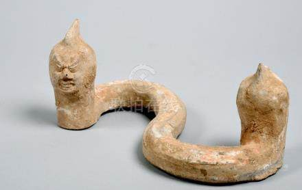 A Chinese Han Dynasty rare and unusual tomb guardian figure of Cixi, the double headed serpent/