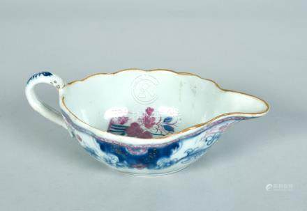 An 18c Chinese low sauceboat decorated in underglaze blue and pink, the interior with floral