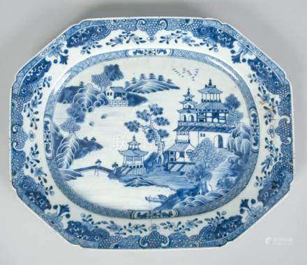 A Chinese blue and white meat dish of shaped rectangular form decorated with a large temple and