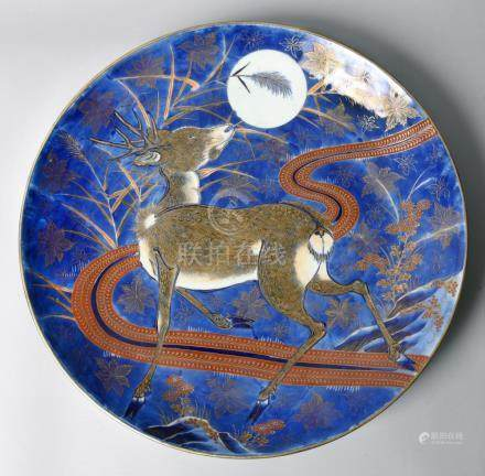 A 19c Oriental charger of underglaze blue ground, decorated with a large stag with in swirling