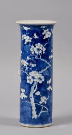A 19c Cantonese cylindrical vase decorated in shades of blue with prunus blossom on cracked ice,