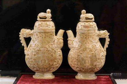 PAIR OF JADE CARVED 'MYTHICAL BEASTS' EWERS WITH LIDS