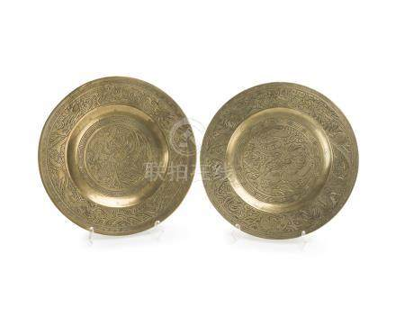 A pair of Chinese brass roundels