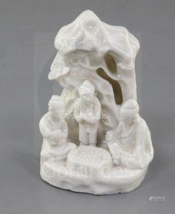 A Chinese Dehua blanc de chine group of Go players, Kangxi period, with three figures underneath a