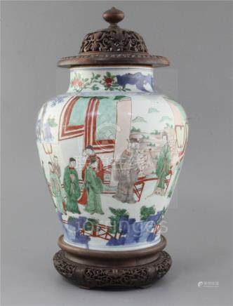 A Chinese wucai baluster jar, Transitional period, 17th century, painted with dignitaries and