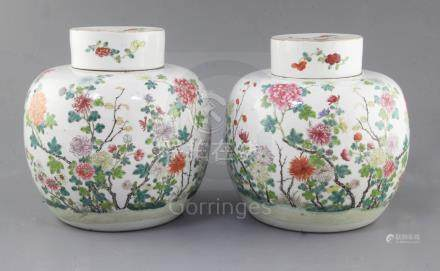A pair of Chinese famille rose globular jars and covers, late 19th century, each finely painted with