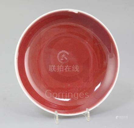 A Chinese sang de boeuf dish, Qianlong mark and probably of the period (1736-1795), the glaze on the