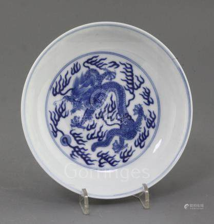 A Chinese blue and white 'dragon' dish, the interior with a single dragon chasing a flaming pearl,