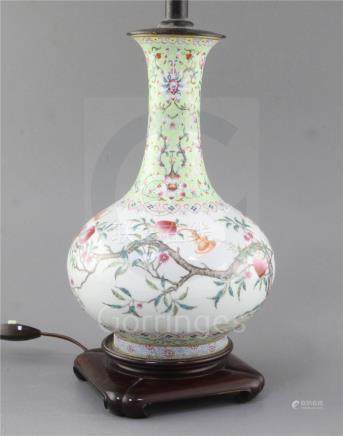 A Chinese famille rose 'nine peach' bottle vase, Qing dynasty, finely painted with nine peach