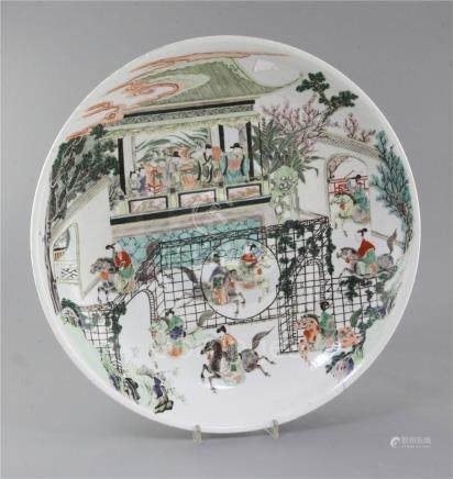 A Chinese famille verte dish, late 19th century, painted with the scene of horsemen performing in