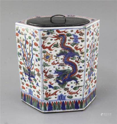 A Chinese wucai hexagonal jar, Wanli mark but later, painted with panels of phoenix and dragon, wood