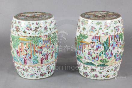 A pair of Chinese famille rose barrel shaped garden seats, c.1830-50, each painted with figures of