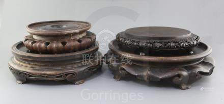 Four Chinese large hardwood stands, late 19th/early 20th century, two with petal lobed borders,