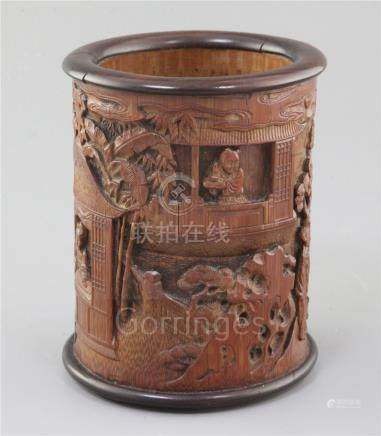 A Chinese bamboo and hongmu mounted brush pot, Qing dynasty, finely carved in high relief with