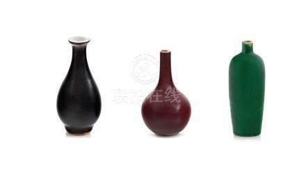 A Chinese 'mirror black' glazed miniature vase, Qianlong period, 1735-1796