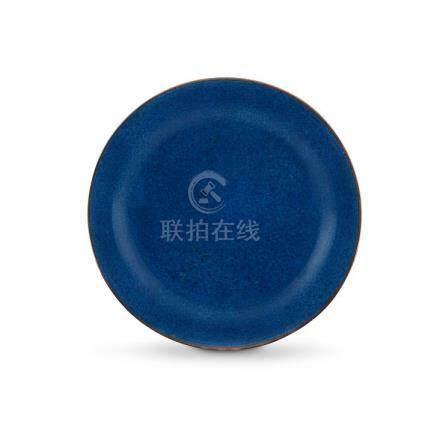 A Chinese powder-blue-glazed saucer-dish, Qing Dynasty, 18th/ 19th century